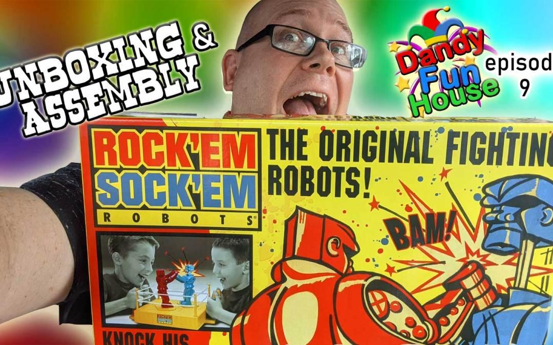 Neil holding box of Rock Em Sock Em Robots