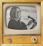 Elizabeth May on an old television