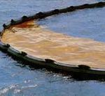 Oil spill containment boom. Via Wikipedia (commons)