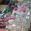 Crystal Delights display case - glass dildos, glass plugs, a bunny tail and more