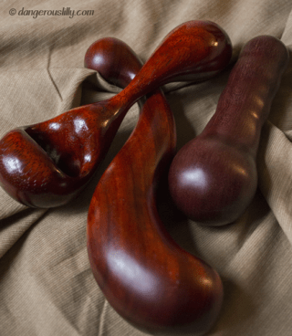 A trio of wood sex toys