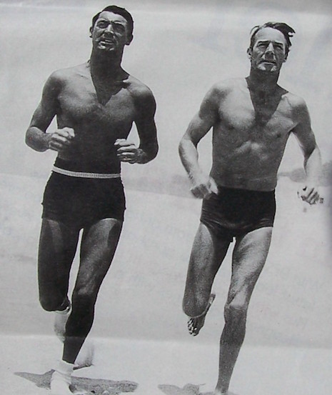 Cary Grant and Randolph Scott running on the beach, 1935