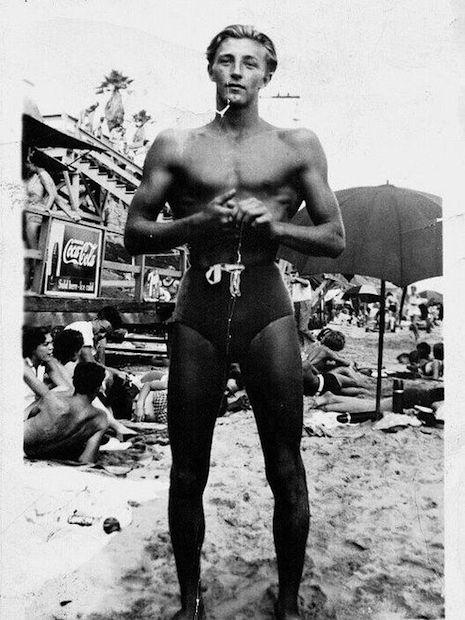 Robert Mitchum at the beach, 1942