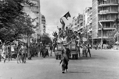 17 April 1975 - Khmer Rouge fighters celebrate as they ent… | Flickr