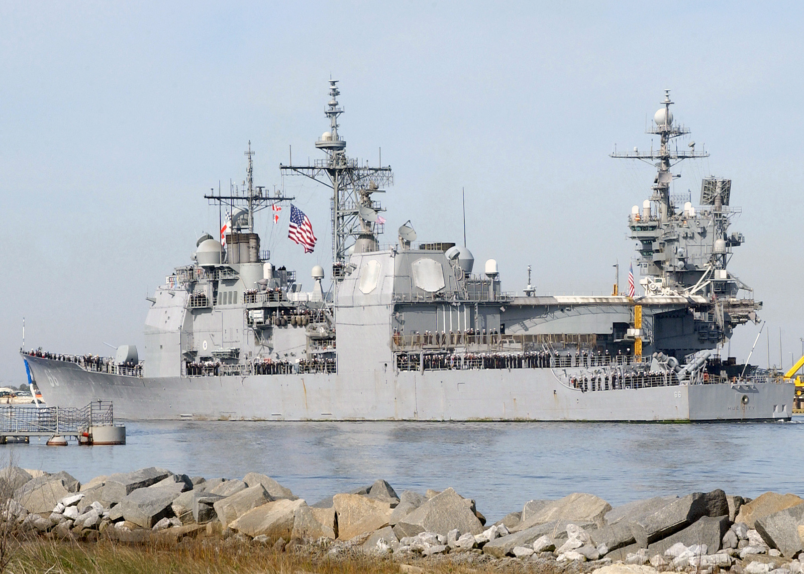 Sailors man the rails of the US Navy (USN) Ticonderoga Class Guided Missile  Cruiser USS HUE