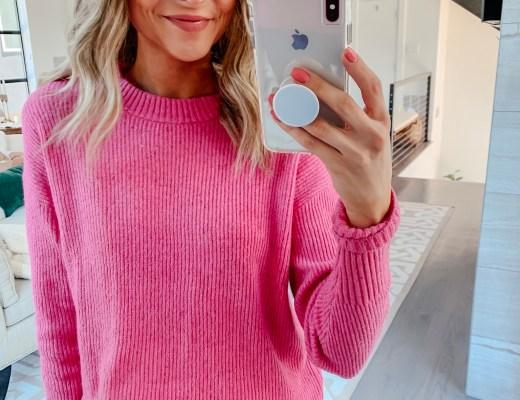 pink something navy sweater