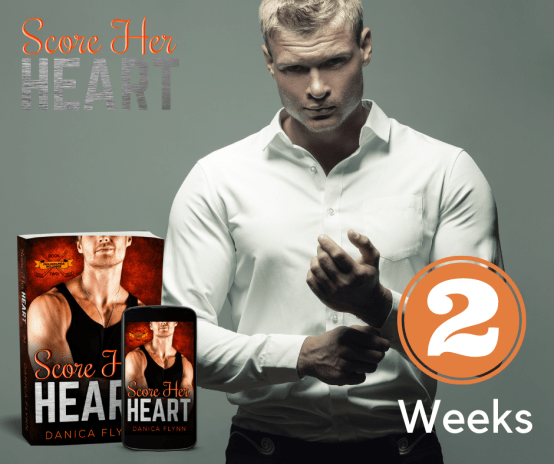 Attractive blond man undoing his cuff links and looking into the camera. 3d mockups of Score Her Heart by Danica Flynn. Score Her Heart logo on top left corner. Image for 2 weeks on bottom right corner