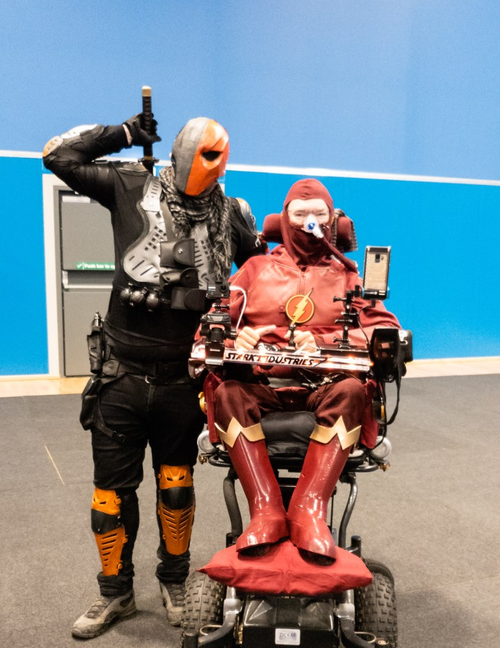 Geekmania Gloucester Daniel Baker dressed as The Flash with a deathstroke cosplayer