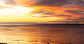 Sunset with beautiful colours reflecting off the water at Clevedon bay