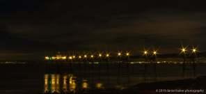 Clevedon Pier illuminated at night