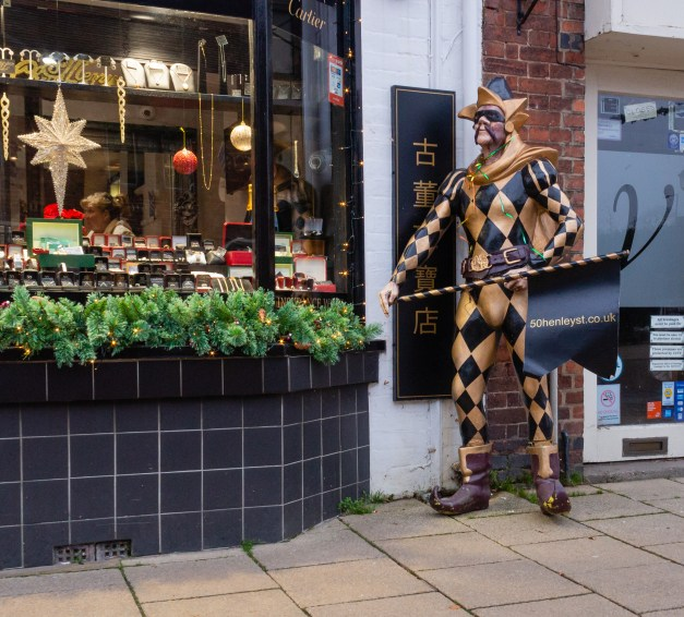 Harlequin statue outside a shop in Stratford-upon-Avon