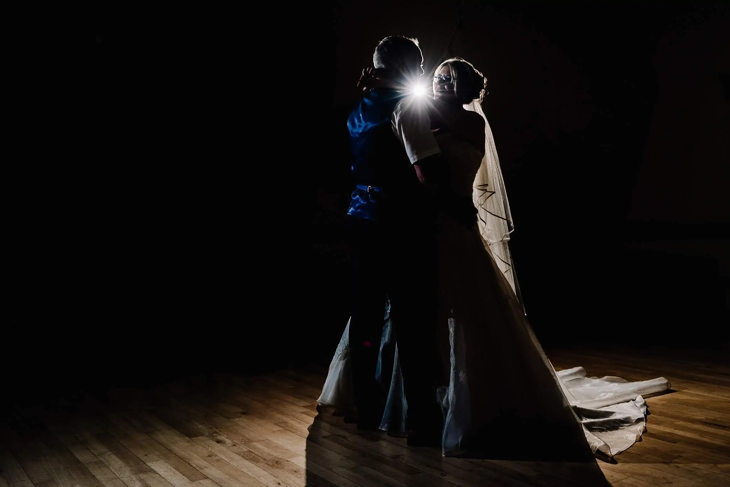 A bride and groom having their first dance at their wedding reception