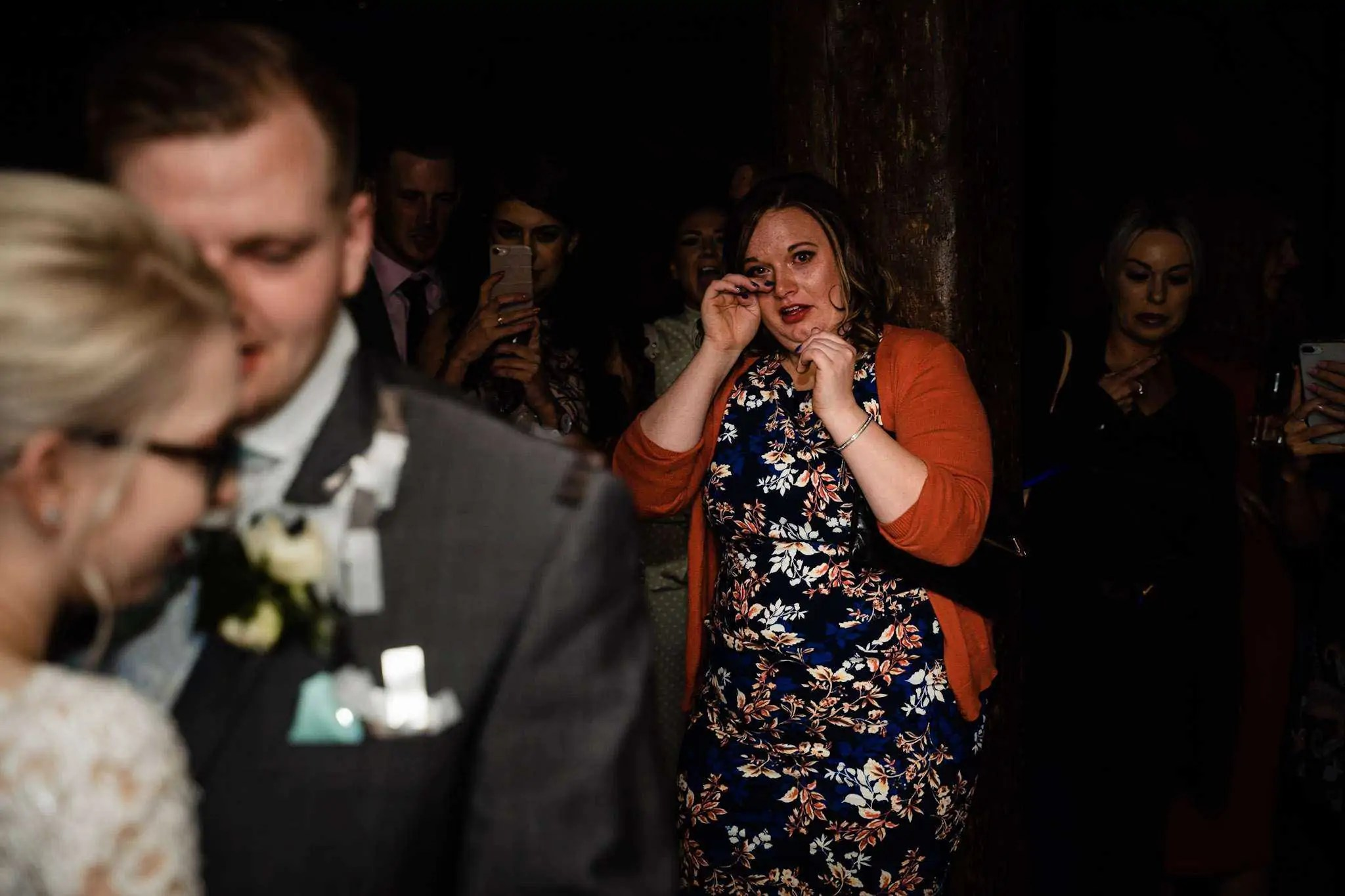 A wedding guest crying during the first dance