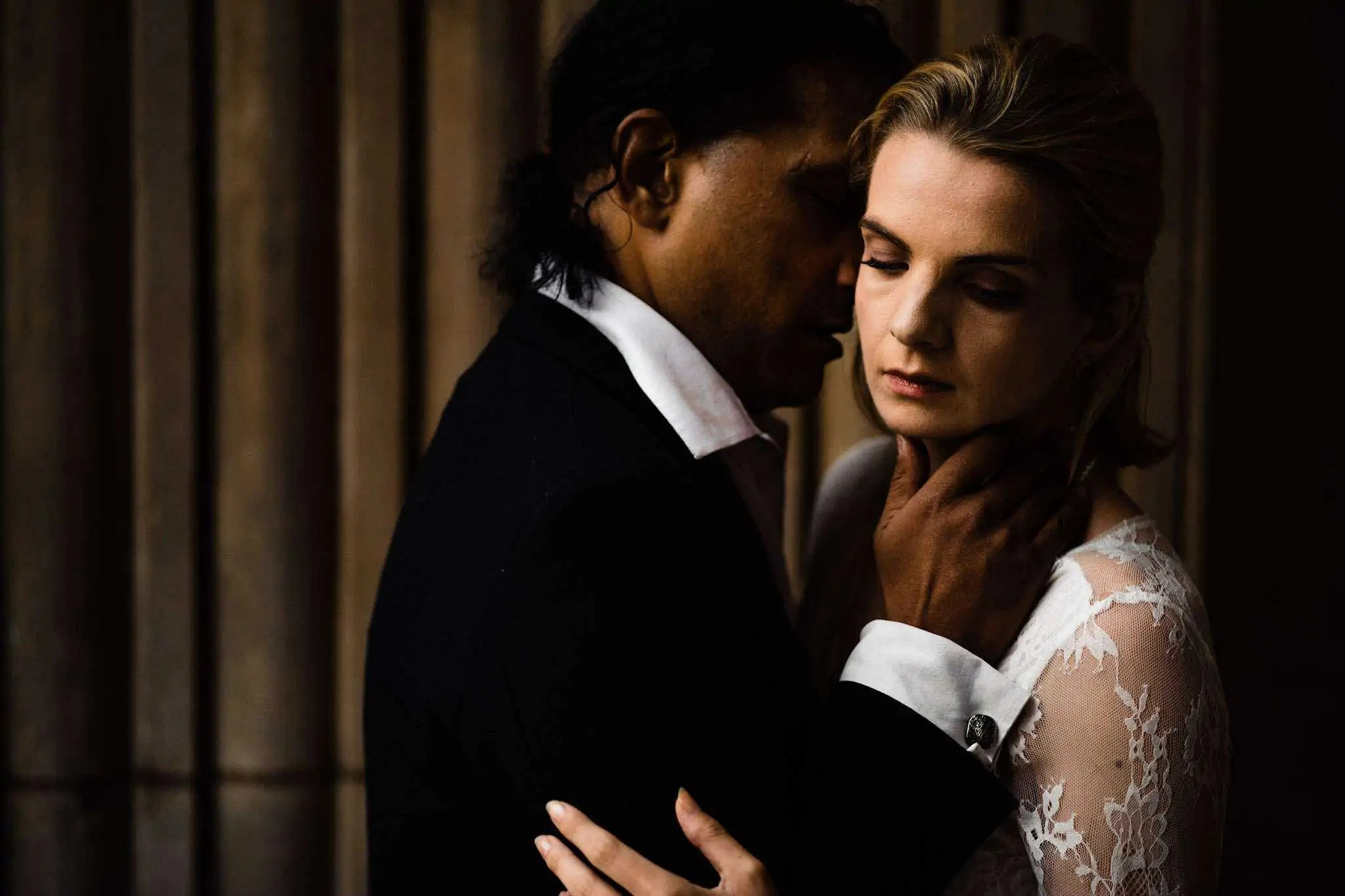 A bride and groom sharing an intimate moment during their couple portraits at St Paul's Cathedral, London