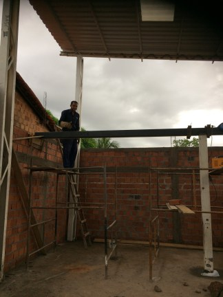 Daniel welds the supporting beam for the mezzanine level