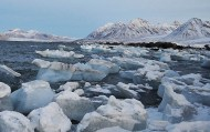 iceberg fragments across shoreline_Ny-Alesund to-