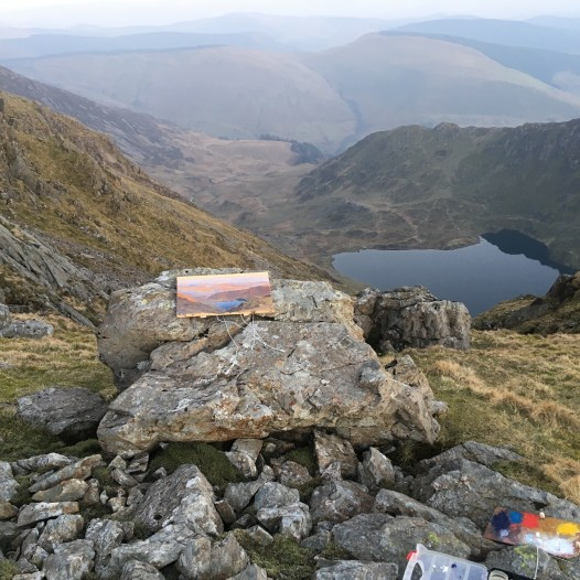 Painting on a rock. Cadair Idris