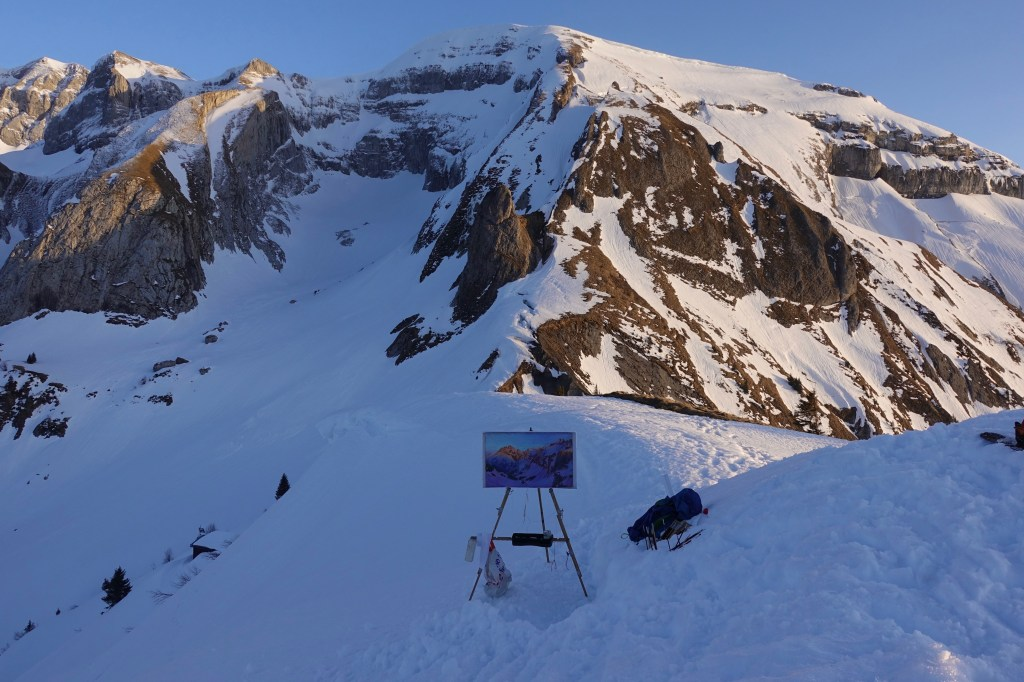 Easel set up in the snow. Painting the Dents du Midi with Sunset