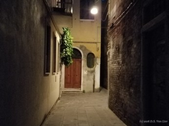 A pedestrian walkway in Venice. Dark alleys are common in Venice.