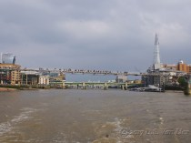 "Millennium Bridge with the ""Walkie-Talkie"" (left) and the Shard (right)in the distance"