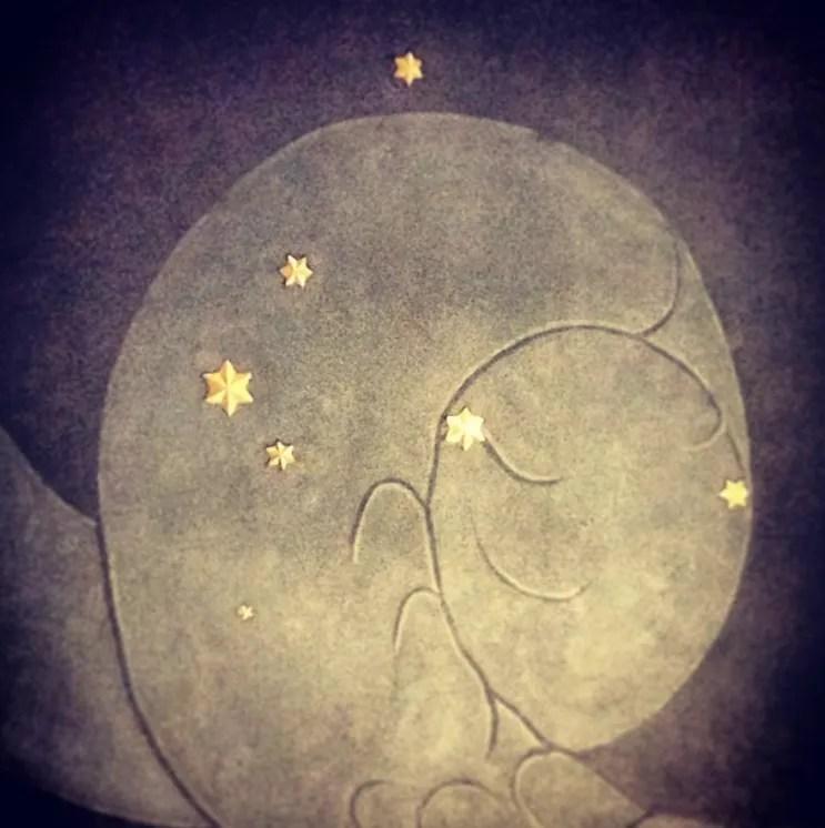 gold stars spiral ceiling art