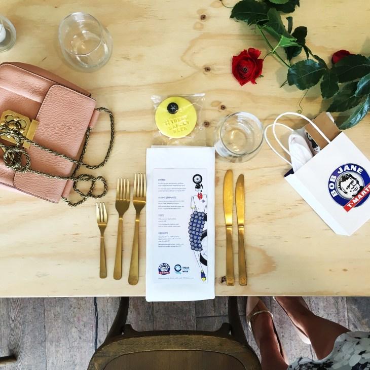 table setting ladies lunch fresh flowers chloe handbag gold cutlery sweet biscuit