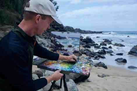 Montana artist Aaron Schuerr on the beach at Mokule'ia Bay
