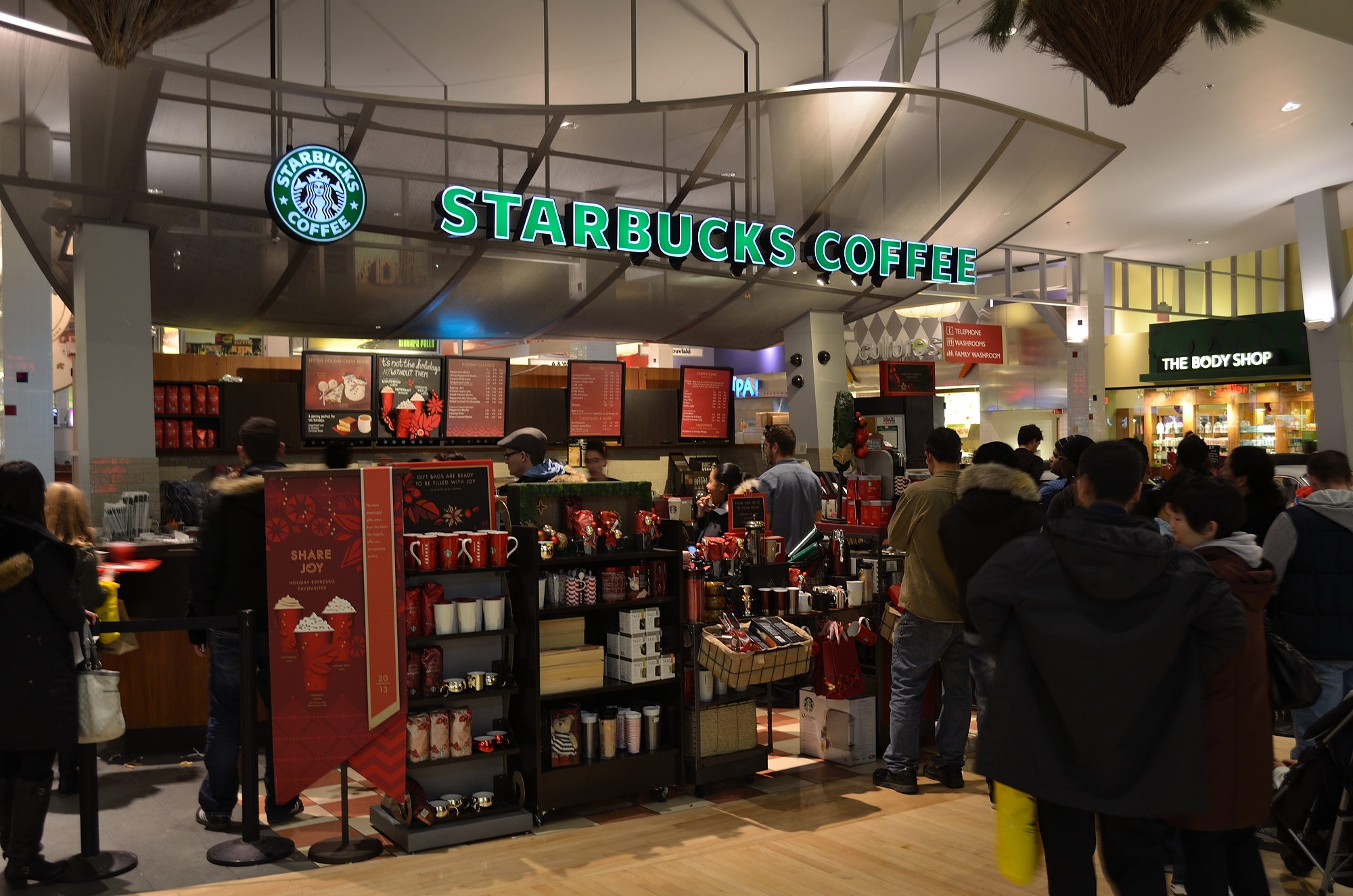 Customers wait in line at a busy Starbucks