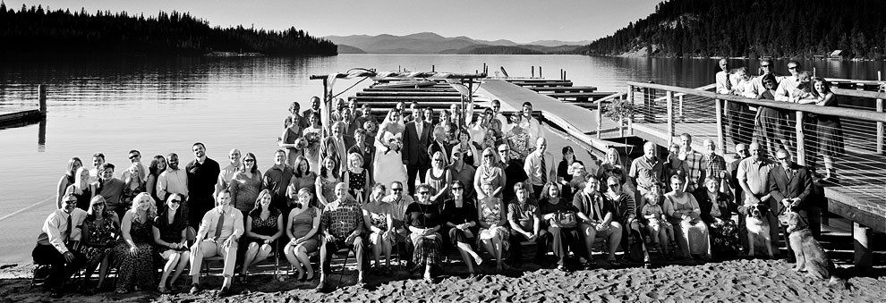 Large group wedding panoramic portrait at a wedding on the shores of Priest Lake Idaho