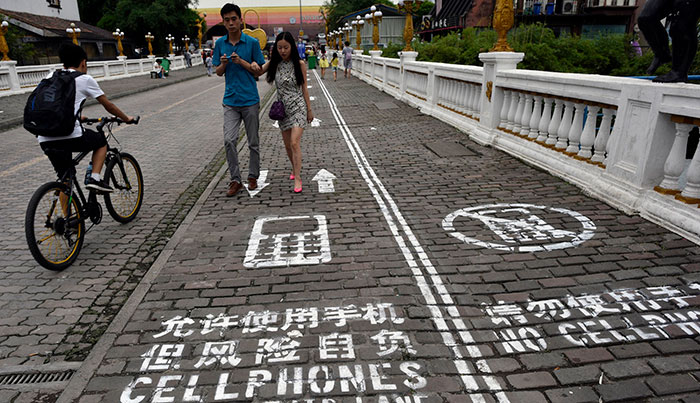 Walk in the phone lane: a sidewalk for people on phones
