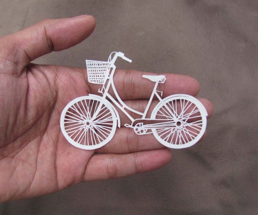 intricate-hand-carved-artworks-from-a-paper-sheet-05