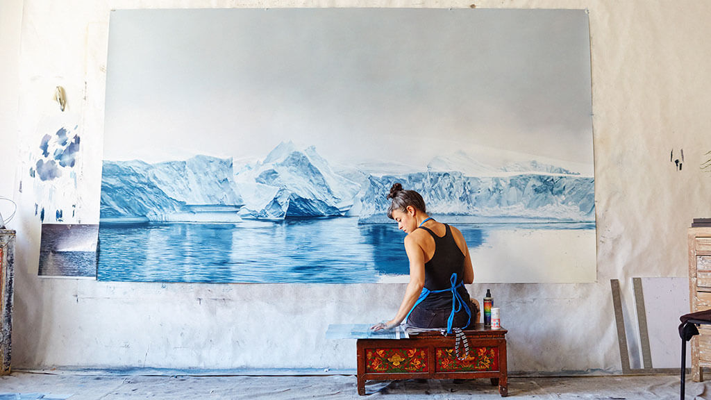 Zaria Forman finger painting icebergs