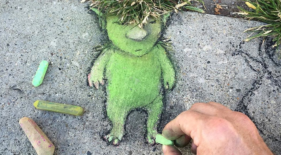 3D chalk art playfully interacts with street objects