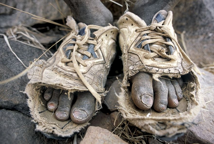 When we met, the boy was carrying his shoes in his hands as he couldn't use them anymore. Traveling prepared makes a difference and with my sewing needle and dental floss, we patched them up, so that he could follow his herd.