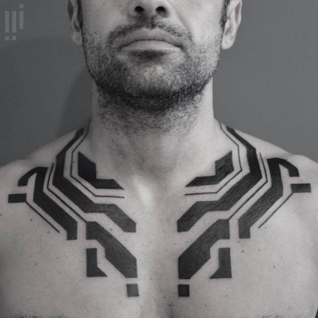 Artist takes inspiration from circuit boards to create futuristic tribal tattoos