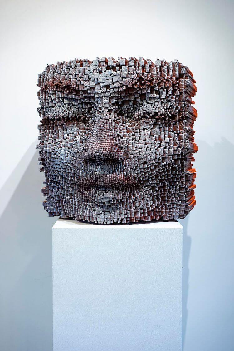 Wooden faces appear deep in thought