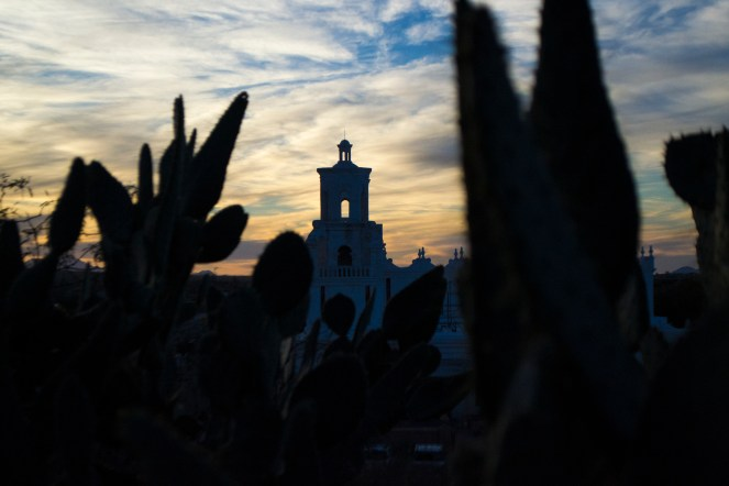 The sun sets behind the San Xavier Del Bac church in southern Arizona. The mission was founded by Fr. Eusebio Kino in 1692.