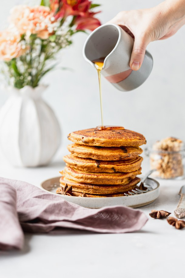 Light and fluffy healthy pumpkin pancakes studded with dark chocolate chips and drizzled with warm maple syrup.