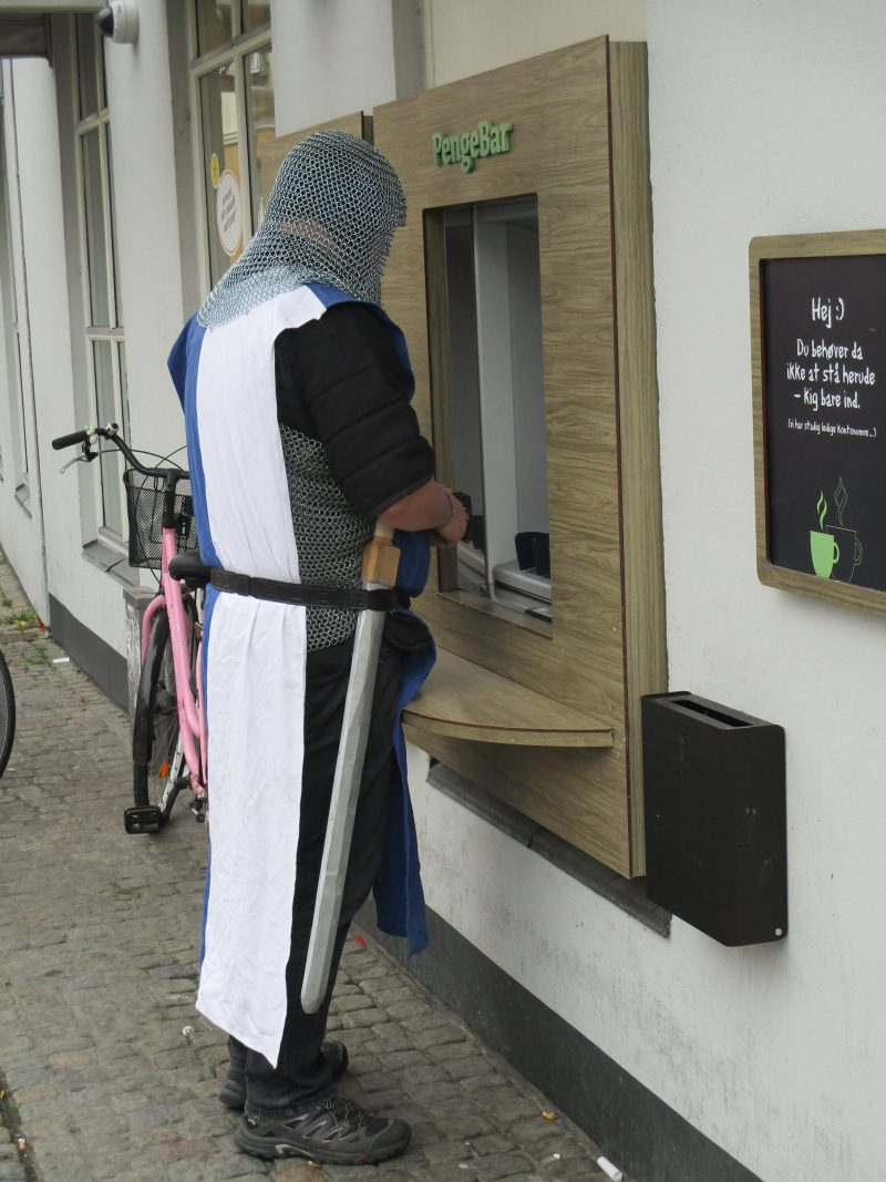 Medieval knight carnival goer at ATM, Aalborg