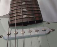 Older Fender truss rod adjustment at bottom of neck