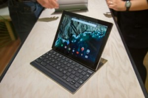 A photo of the Google Pixel C tablet stood on a white bench with the optional keyboard