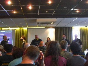 A photo of the presenters lined up on stage at the first OggCamp in Wolverhampton