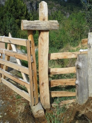 Another gate hinge. Note that the top horizontal piece has a square hole the size of a chain saw blade.