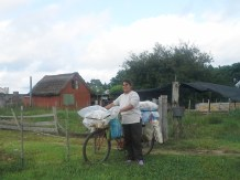 This woman delivers bread throughout the pueblo every morning by bicycle.