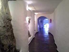 A hallway within Casa Pueblo. Note the raw rock displayed on one side and the lack of straight lines.