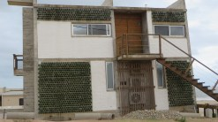 A house with wine bottle walls.