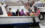 Islanders commuting to Puno to sell their wares and buy oil and rice.