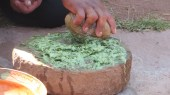 Using a broad mortar and pestal to make soap