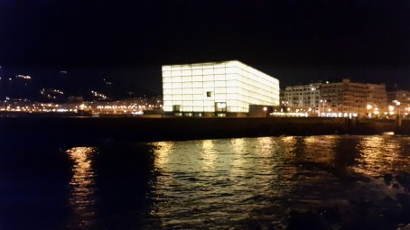 San Sebastian cube building at night. It is unusual in that all of the sides are not quite straight
