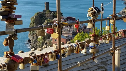 Cinque Terre - love locks and Vernazza in the background